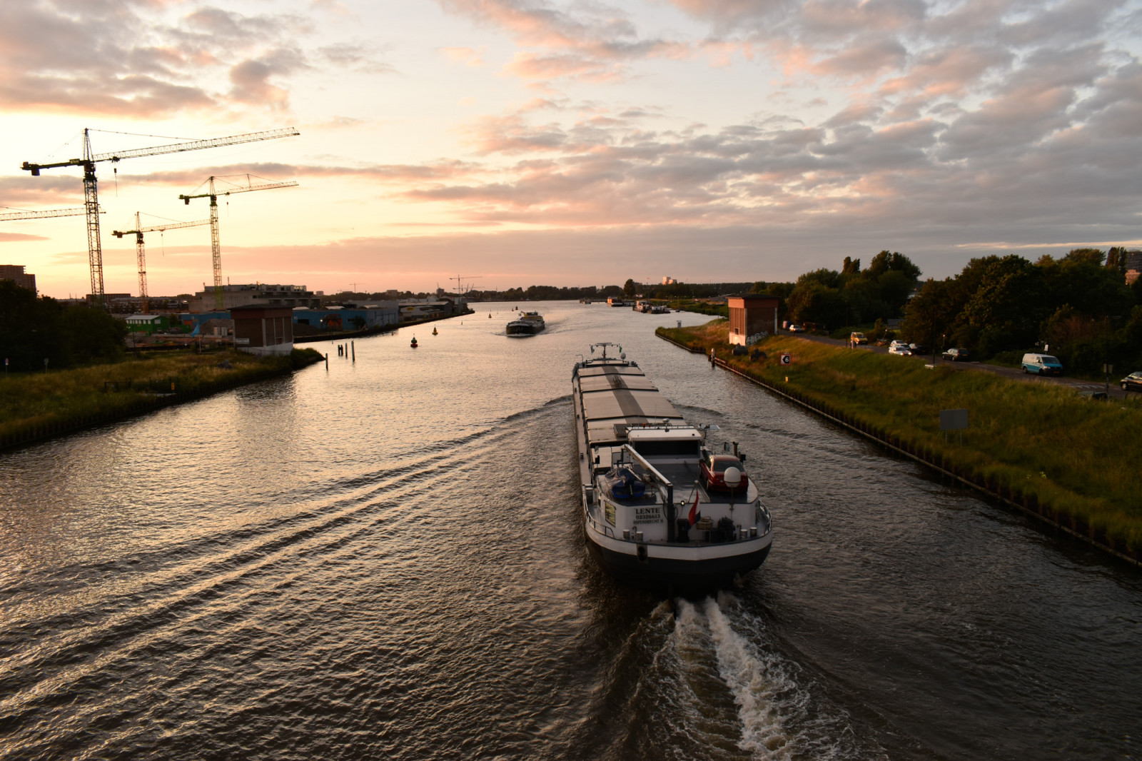 sky-above-canal-freigh-ship-dutch-canals