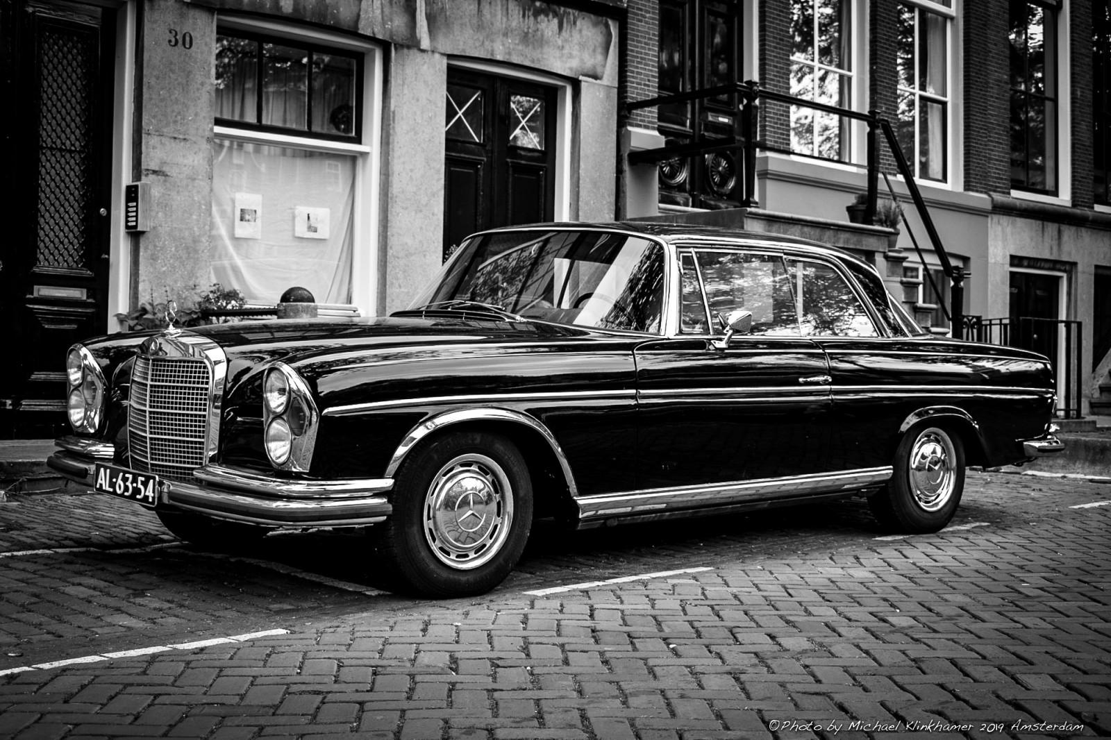 Black Mercedes-Benz 280SE Coupe